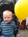 Conor with his balloon from mental health charity MIND